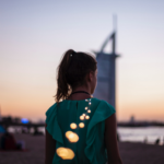 Girl in front of Burj Khalifa - Xploredubai