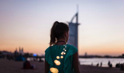 Girl in front of Burj Khalifa - Xploredubai