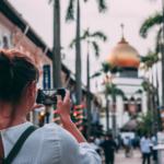 Girl taking photo while travelling - Xploredubai