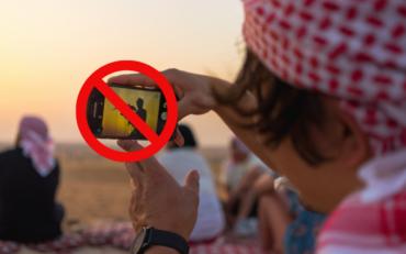 boy taking selfie arab