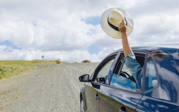 women feeling the fresh air from car